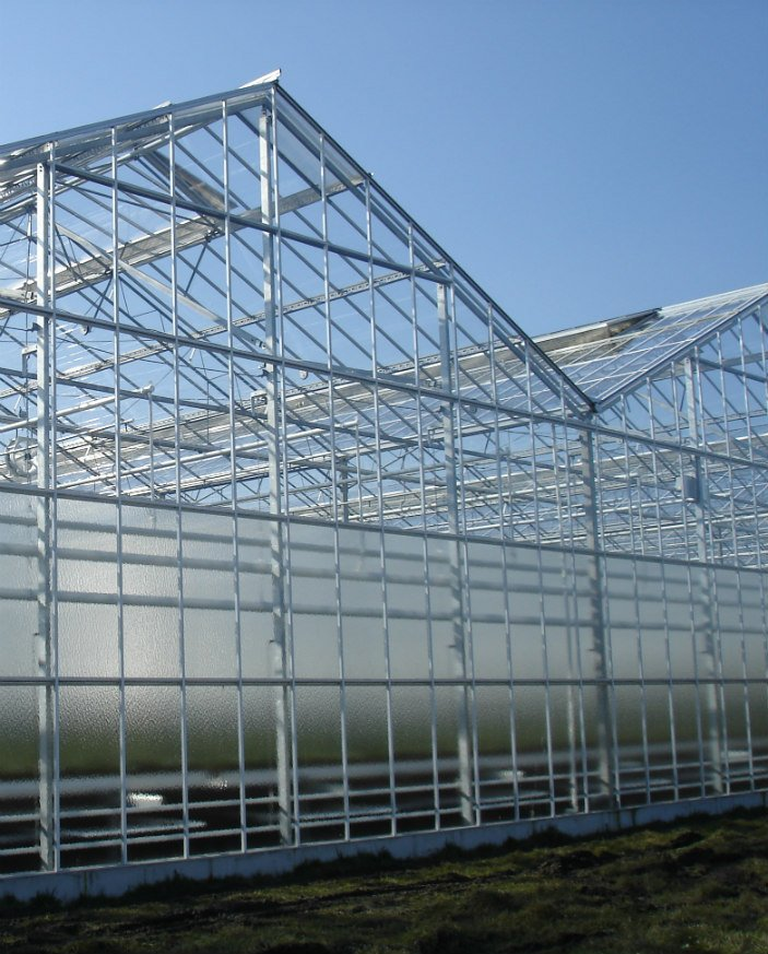 An image of an Alcomij's widespan greenhouse roof system. A system that is mainly used for garden centres
